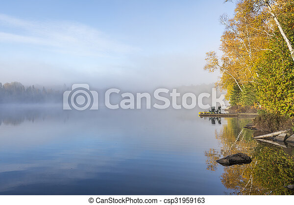 Misty Morning on a Lake in Autumn - csp31959163