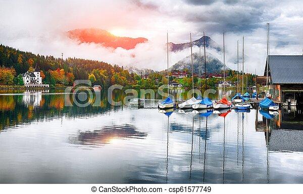 Misty morning on the lake Grundlsee Alps Austria Europe - csp61577749