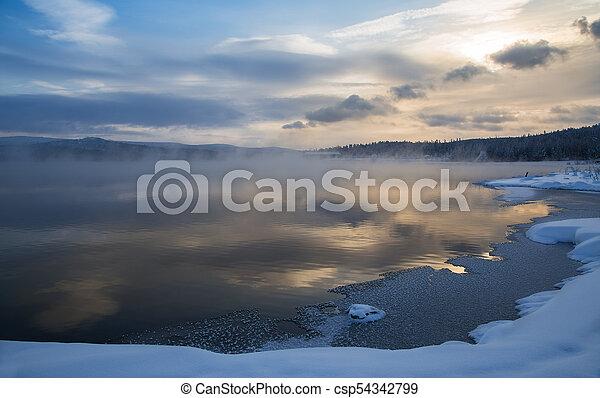 Misty sunset on the lake - csp54342799