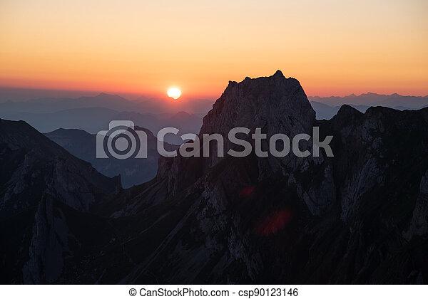Misty sunset with beautiful silhouette of mountain range in Switzerland - csp90123146