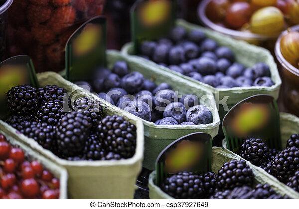 mixed berries at eco market - csp37927649