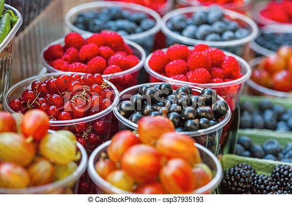 mixed berries at eco market - csp37935193