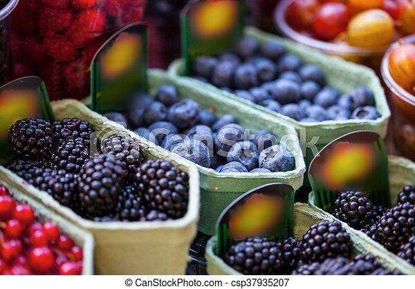 mixed berries at eco market - csp37935207