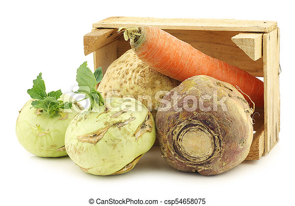 mixed cabbage and root vegetables in a wooden crate - csp54658075