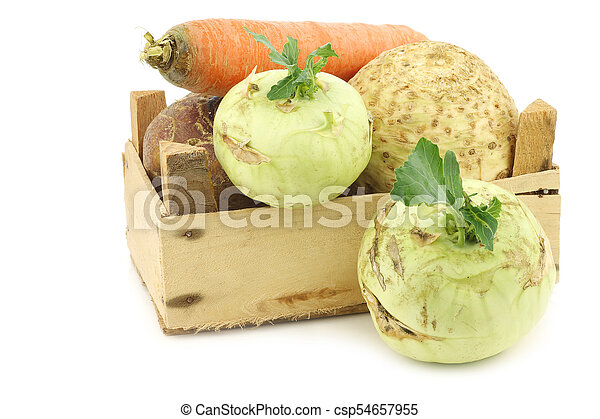 mixed cabbage and root vegetables in a wooden crate - csp54657955