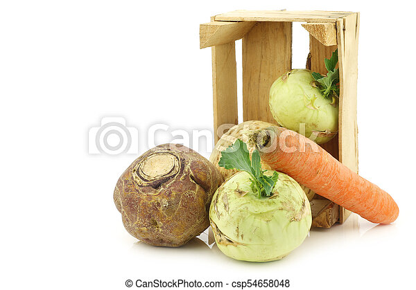 mixed cabbage and root vegetables in a wooden crate - csp54658048