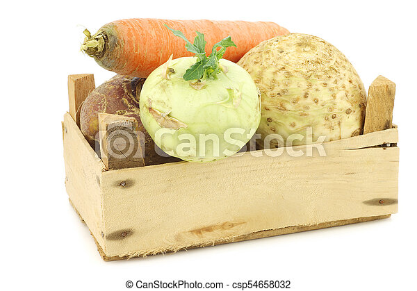 mixed cabbage and root vegetables in a wooden crate - csp54658032