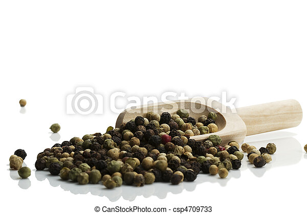 mixed peppercorns with a wooden shovel on white background - csp4709733