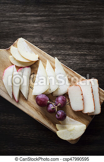 mixed portuguese cheese tapas snack platter with apple and grapes