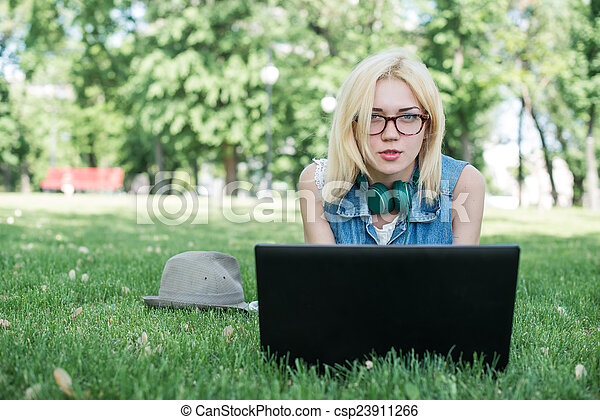 Mixed race college student sitting - csp23911266