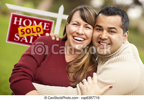 Mixed Race Couple in Front of Sold Real Estate Sign - csp6387719