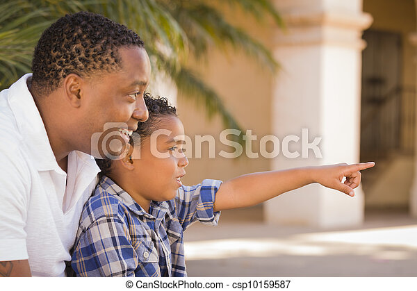 Mixed Race Father and Son Pointing in the Park - csp10159587