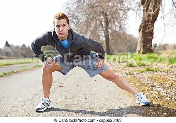 Mixed race man stretching - csp6620463