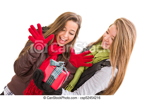 Mixed Race Young Adult Females Holding A Christmas Gift Isolated on a White Background. - csp52454216