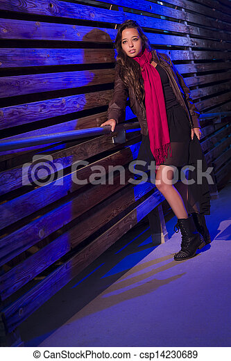 Mixed Race Young Adult Woman Against a Wood Wall Background - csp14230689