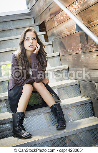 Mixed Race Young Adult Woman Portrait on Staircase - csp14230651