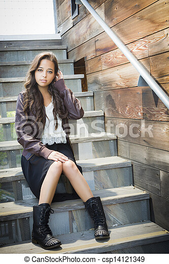 Mixed Race Young Adult Woman Portrait on Staircase - csp14121349