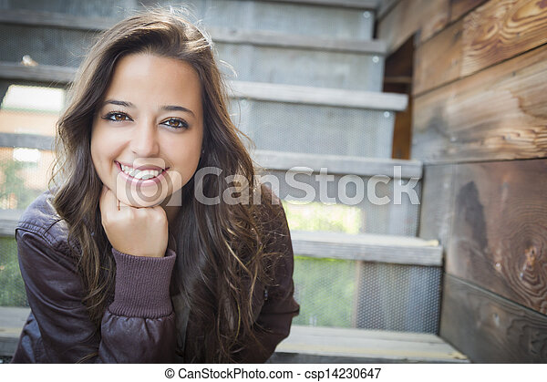 Mixed Race Young Adult Woman Portrait on Staircase - csp14230647
