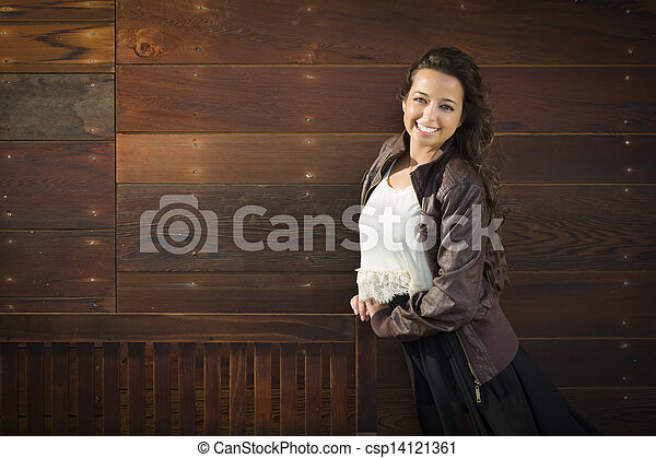 Mixed Race Young Adult Woman Portrait Against Wooden Wall - csp14121361