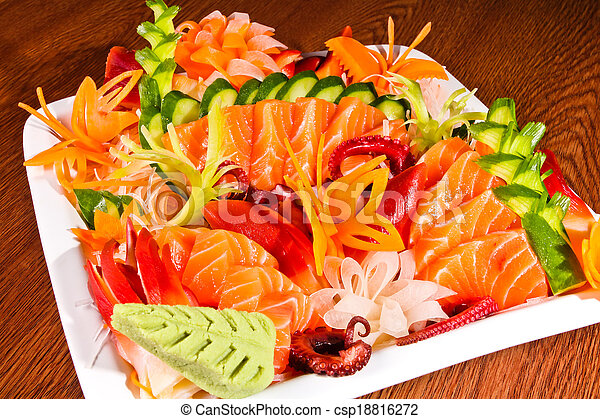 Mixed sashimi in white plate on wood table - csp18816272