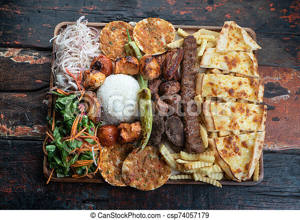 Mixed Turkish Kebab Plate On Rustic Wooden Table Mixed Turkish Kebab Plate Isolated On Rustic Wooden Table Canstock