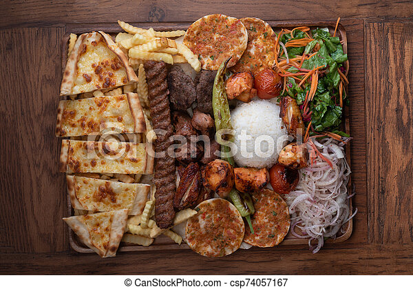 Mixed Turkish Kebab Plate On Wooden Background Mixed Turkish Kebab Plate Isolated On Wooden Background Canstock