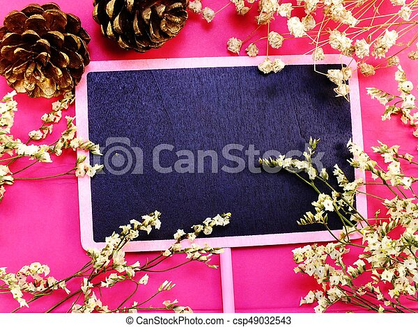 mock up black wooden background with flowers blossom decorations