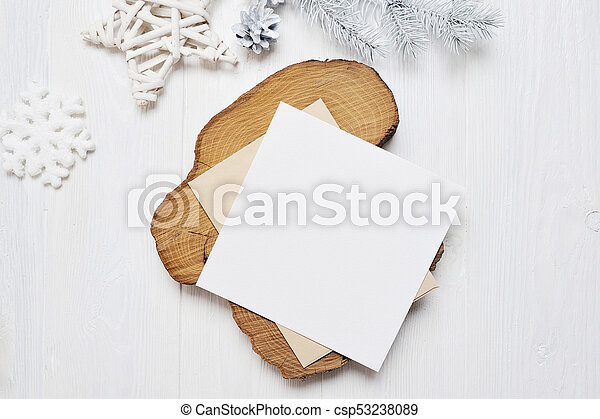 Mockup Christmas greeting card letter in envelope with white tree, flatlay on a white wooden background, with place for your text - csp53238089
