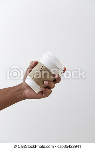 Mockup of male hand holding a coffee paper cup - csp85422941