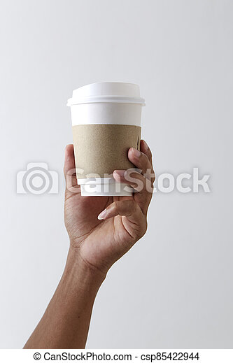 Mockup of male hand holding a coffee paper cup - csp85422944