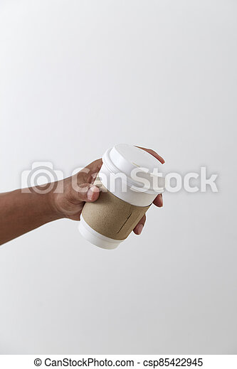 Mockup of male hand holding a coffee paper cup - csp85422945