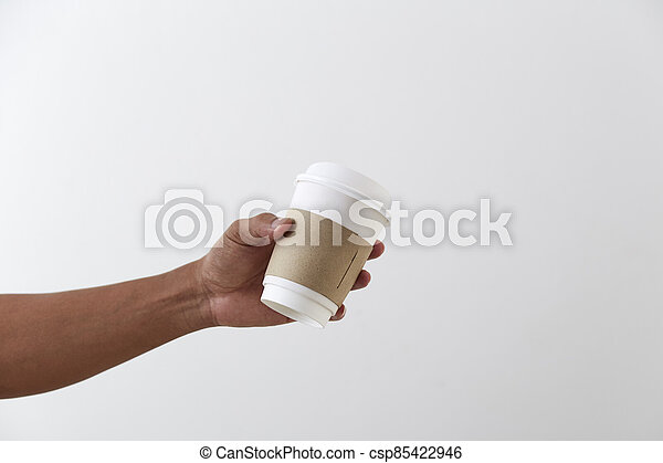 Mockup of male hand holding a coffee paper cup - csp85422946