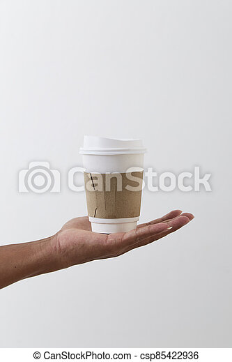 Mockup of male hand holding a coffee paper cup - csp85422936