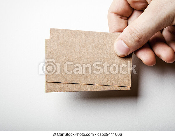 Mockup of two craft business cards and mans hand. - csp29441066