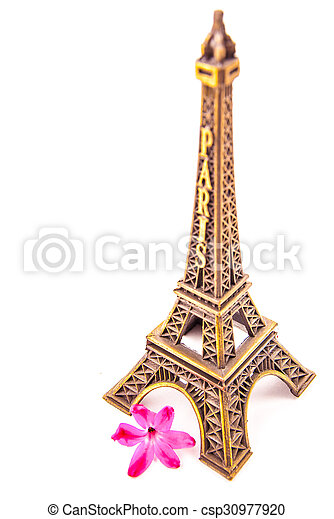 Model Of Little Eiffel Tower With A Pink Flower Isolated On White