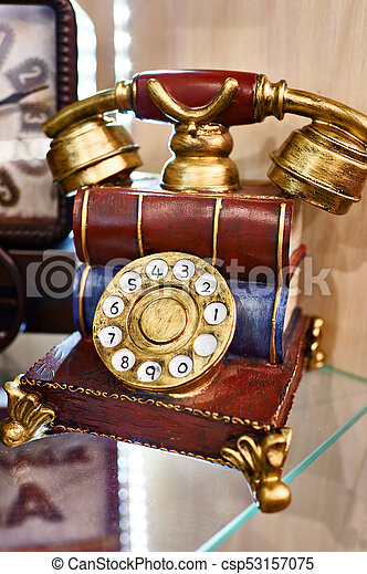 Model of vintage telephone with dial - csp53157075