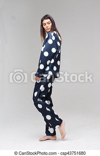 Model posing in a polka dot costume pajamas - csp43751680