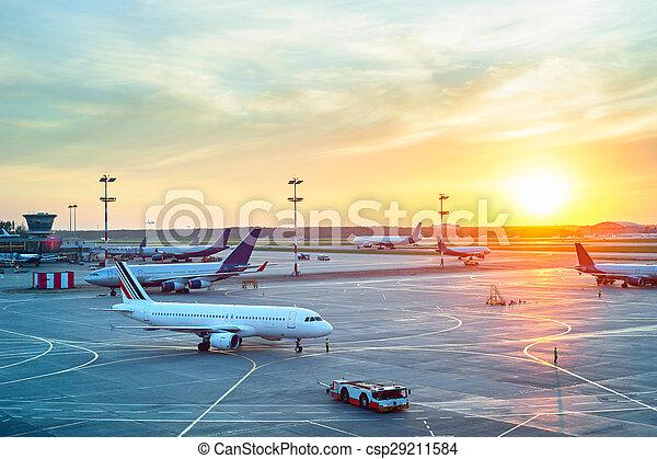 Modern airport at sunset - csp29211584
