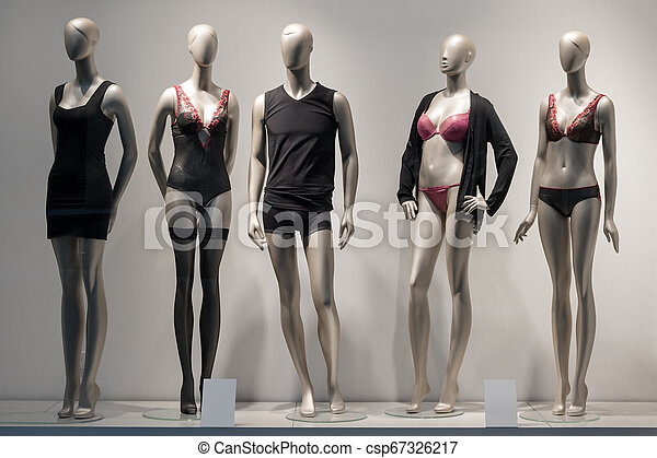 Modern and luxury shop of underwear. Full-length male and female mannequins in nderwear. Lingerie on plastic dolls in store window display. - csp67326217