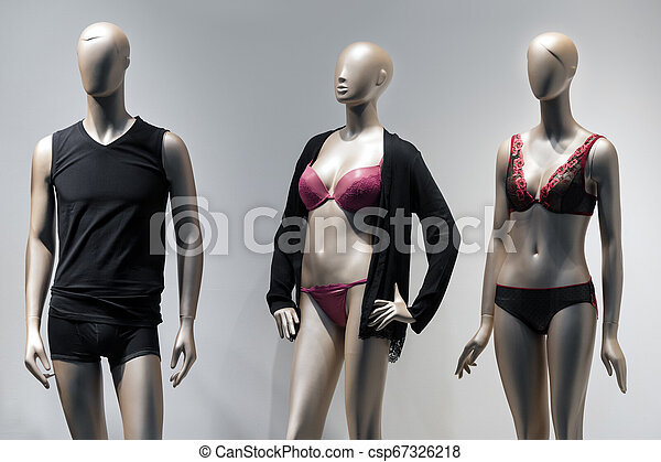 Modern and luxury shop of underwear. Full-length male and female mannequins in nderwear. Lingerie on plastic dolls in store window display. - csp67326218