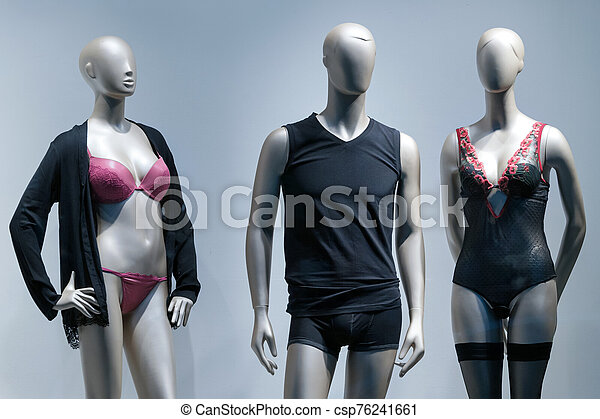 Modern and luxury shop of underwear. Full-length male and female mannequins in nderwear. Lingerie on plastic dolls in store window display. - csp76241661