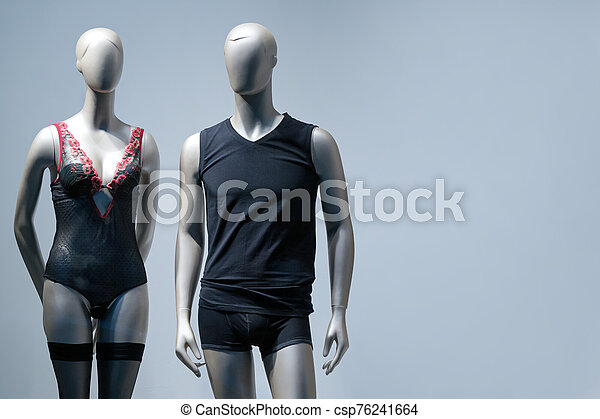 Modern and luxury shop of underwear. Full-length male and female mannequins in nderwear. Lingerie on plastic dolls in store window display. - csp76241664