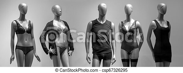 Modern and luxury shop of underwear. Full-length male and female mannequins in nderwear. Lingerie on plastic dolls in store window display. - csp67326295