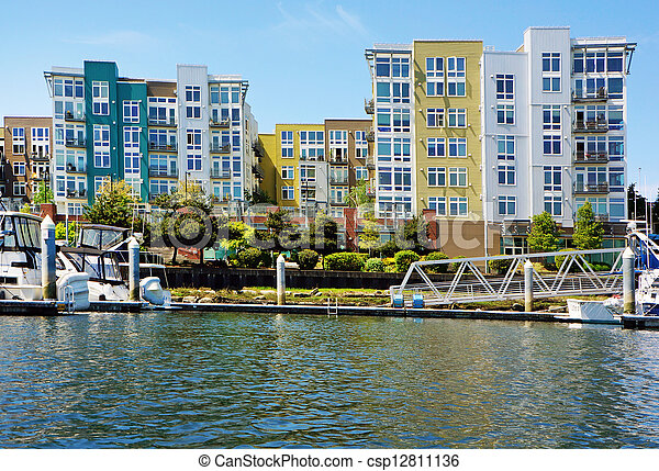 https://comps.canstockphoto.com/modern-apartment-building-exterior-stock-photos_csp12811136.jpg