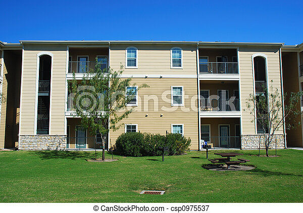 Modern apartment house with green lawn - csp0975537