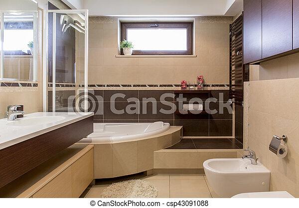 Modern beige and brown bathroom - csp43091088