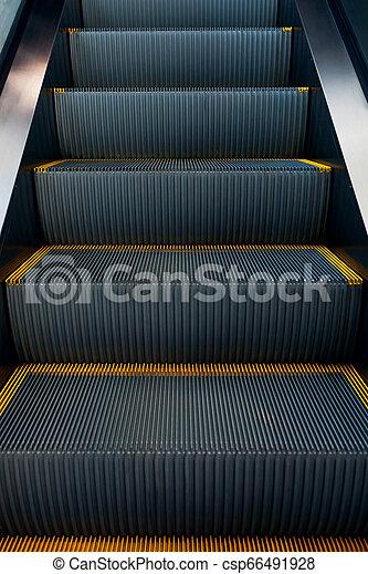 Modern escalator in shopping center. Electronic system moving. Empty escalator - csp66491928