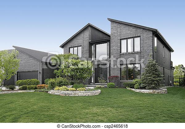 Modern gray brick home - csp2465618