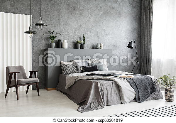 Modern Grey Bedroom Interior With Big Bed With Pillows And Linen