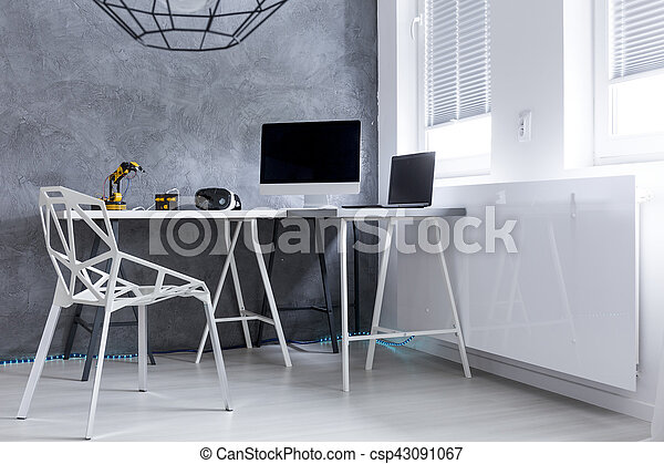 Modern grey room with computer on a desk - csp43091067